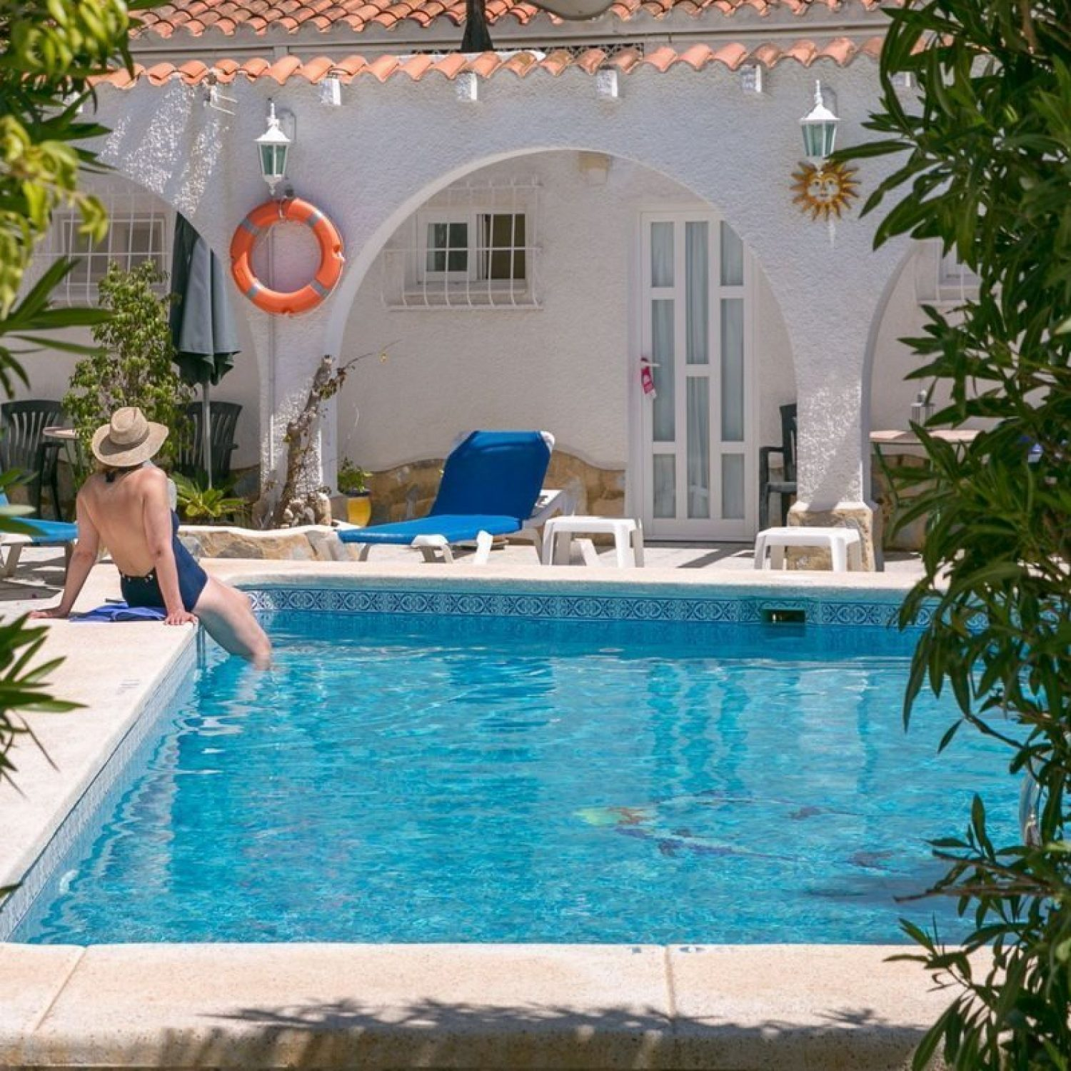 A lady enjoying the magnesium pool at La Crisalida Retreats, health and wellbeing retreat, Spain, to cleanse the skin