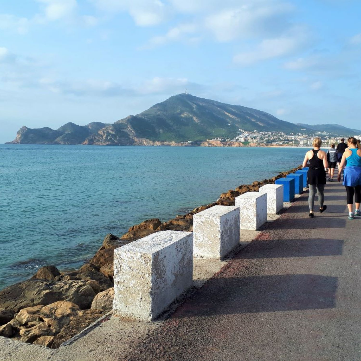 Guests on a beach walk at La Crisalida Retreats, health and wellbeing retreat, Spain, for a lymphatic cleanse.