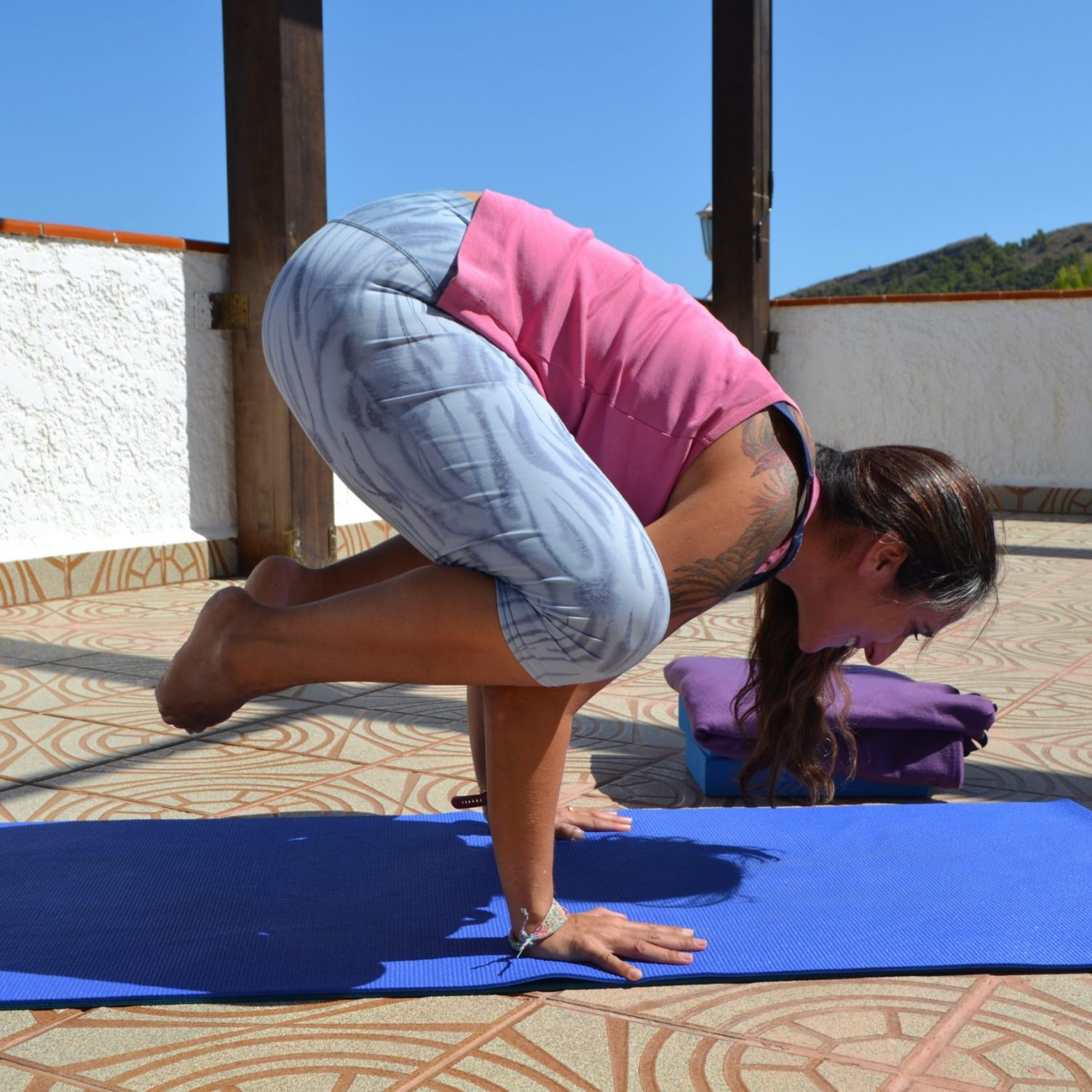 Challenge your balance in yoga Crow pose Yoga Retreat Spain